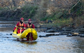 Firefighters use a raft as they search Monday for a missing woman along the banks of the south branch of the Thames River near Wellington Road in London. Heidi Holm, 77, was last seen at Wellington and Frank Place about 11 p.m. Sunday. An unidentified body was found Monday. (CRAIG GLOVER, The London Free Press)