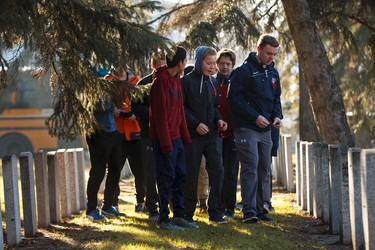 Students lay poppies during No Stone Left Alone at Beechmount Cemetary in Edmonton, Alta., on Tuesday, November 10, 2015. This year marks the 5th annual commemoration ceremonies for the No Stone Left Alone Memorial Foundation. School children from across Canada lay poppies on veterans graves ahead of Remembrance Day. Ian Kucerak/Edmonton Sun/Postmedia Network
