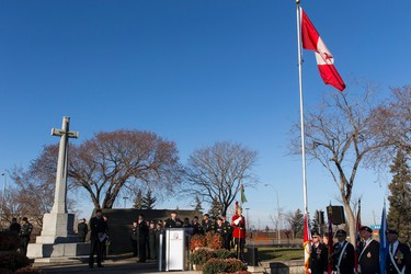 Brigadier-General Wayne D. Eyre (at podium) speaks during No Stone Left Alone at Beechmount Cemetary in Edmonton, Alta., on Tuesday, November 10, 2015. This year marks the 5th annual commemoration ceremonies for the No Stone Left Alone Memorial Foundation. School children from across Canada lay poppies on veterans graves ahead of Remembrance Day. Ian Kucerak/Edmonton Sun/Postmedia Network