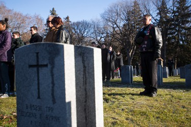 Veterans and family members take part in the ceremony during No Stone Left Alone at Beechmount Cemetary in Edmonton, Alta., on Tuesday, November 10, 2015. This year marks the 5th annual commemoration ceremonies for the No Stone Left Alone Memorial Foundation. School children from across Canada lay poppies on veterans graves ahead of Remembrance Day. Ian Kucerak/Edmonton Sun/Postmedia Network
