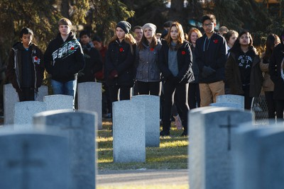 Students listen to the ceremony during No Stone Left Alone at Beechmount Cemetary in Edmonton, Alta., on Tuesday, November 10, 2015. This year marks the 5th annual commemoration ceremonies for the No Stone Left Alone Memorial Foundation. School children from across Canada lay poppies on veterans graves ahead of Remembrance Day. Ian Kucerak/Edmonton Sun/Postmedia Network