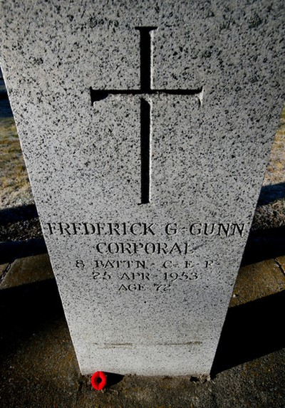 Corporal Frederick G. Gunn's  headstone has a new poppy at its base at Westlawn Funeral Home & Cemetery at 10132-163rd Street on Nov. 10, 2015, during the 5th annual No Stone Left Alone commemoration ceremonies that occurred across Edmonton and Canada. The organization started in Edmonton and has now spread across Canada. It is the goal of the No Stone Left Alone Memorial Foundation to recognize the sacrifices of the military members and place a poppy, the symbol of Remembrance on every headstone across Canada. Tom Braid/Edmonton Sun/Postmedia Network