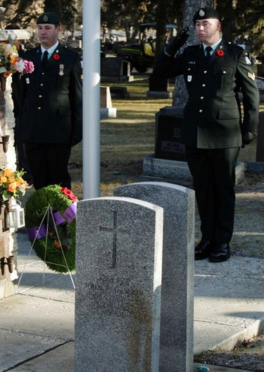 A solder salutes at Westlawn Funeral Home & Cemetery at 10132 - 163rd Street on Nov. 10, 2015, during the 5th annual No Stone Left Alone commemoration ceremonies that occurred across Edmonton and Canada. The organization started in Edmonton and has now spread across Canada. It is the goal of the No Stone Left Alone Memorial Foundation to recognize the sacrifices of the military members and place a poppy, the symbol of Remembrance on every headstone across Canada. Tom Braid/Edmonton Sun/Postmedia Network