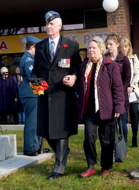 Bill Sergeant, with his stepmother Mary Lou Sergeant, and nieces Olivia and Victoria, at the unveiling of a memorial plaque at the Tillsonburg cenotaph donated by Bill's father, Jim Sergeant, who passed away in November 2013. (CHRIS ABBOTT/TILLSONBURG NEWS)