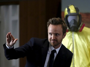"""Cast member Aaron Paul, who played the character Jesse Pinkman in the award-winning television series """"Breaking Bad"""", is introduced during a donation of the show's memorabilia at the Smithsonian Museum of American History in Washington November 10, 2015. Paul wore the yellow Tyvek suit in the series.       REUTERS/Gary Cameron"""
