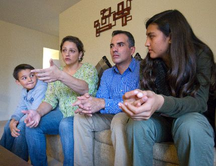 Johanna Regalado describes how her husband, Edgar, was shot at by a man on a motorcycle in Colombia after he denied a FARC member a bank loan while sitting with their son, Juan, 8, and daughter, Laura, 13, in their apartment in London, Ont. on Thursday November 12, 2015. The family left Colombia over two years ago. (CRAIG GLOVER< The London Free Press)