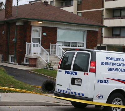 Police at the scene Nov. 12, 2015, a day after the slaying of Stella Tetsos, 82, in her home. (Veronica Henri/Toronto Sun)