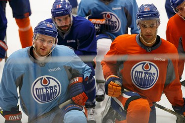 Edmonton's defenceman Eric Gryba (62), forward Teddy Purcell (16) and defenceman Darnell Nurse (25) listen to head coach Todd McLellan speak during an Edmonton Oilers practice at Clareview Recreation Centre in Edmonton, Alta., on Monday November 16, 2015. The Oilers play the Chicago Blackhawks at Rexall Place on Nov. 18, 7:30 p.m. Ian Kucerak/Edmonton Sun/Postmedia Network