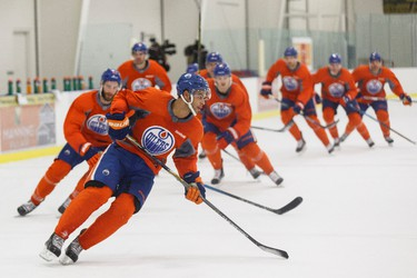 Edmonton's defenceman Darnell Nurse (centre) exercises alongside other players during an Edmonton Oilers practice at Clareview Recreation Centre in Edmonton, Alta., on Monday November 16, 2015. The Oilers play the Chicago Blackhawks at Rexall Place on Nov. 18, 7:30 p.m. Ian Kucerak/Edmonton Sun/Postmedia Network