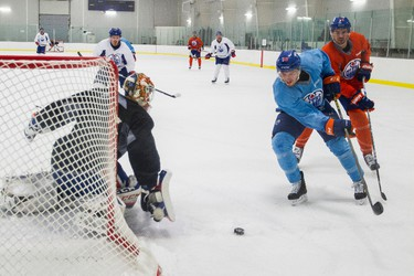 Edmonton's goaltender Cam Talbot (left), forward Andrew Miller (centre) and defenceman Justin Schultz run a drill during an Edmonton Oilers practice at Clareview Recreation Centre in Edmonton, Alta., on Monday November 16, 2015. The Oilers play the Chicago Blackhawks at Rexall Place on Nov. 18, 7:30 p.m. Ian Kucerak/Edmonton Sun/Postmedia Network
