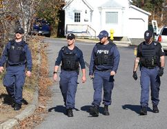 John Lappa/Sudbury Star Greater Sudbury Police canvass the Melvin Avenue neighbourhood after 51-year-old resident Marcel Couillard was found dead in this file photo. Reginald Berard, 23, of the Whitefish Lake First Nation, has since been charged with second-degree murder.
