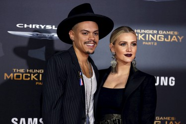 """Cast member Evan Ross and his wife Ashlee Simpson pose at the premiere of """"The Hunger Games: Mockingjay - Part 2"""" in Los Angeles, California November 16, 2015. The movie opens in North America on November 20.  REUTERS/Mario Anzuoni"""