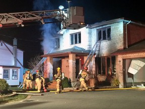 Ottawa firefighters battle a house blaze on Normandy Cres., on Monday, Nov. 16, 2015. It has been deemed suspicious by the arson squad. (COREY LAROCQUE Ottawa Sun/Postmedia Network)