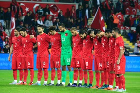 Turkey's players observe a minute of silence to honour the victims of the Paris attacks prior to an international friendly against Greece in Istanbul Tuesday Nov. 17, 2015. (AP Photo/Lefteris Pitarakis)