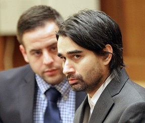 Derek Medina, right, looks at the prosecuting attorney as he speaks on the fourth day of his murder trial at Miami Criminal courts on Monday, Nov. 16, 2015 in Miami. Medina is accused of murdering his wife in 2013 then posting a photo of her body on Facebook.  (C.M. Guerrero/El Nuevo Herald via AP, Pool)