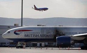 A damaged British Airways Boeing 777-200 sits at McCarran International Airport Wednesday, Sept. 9, 2015, in Las Vegas. An engine caught fire before takeoff Tuesday forcing the evacuation of the crew and passengers. (AP Photo/John Locher)