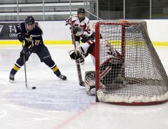 Mackenzie Dachuk, left, of the Bantam AAA Peace Country Storm, tries to get a backhand shot on net against the Red Deer Chiefs in Alberta Major Bantam Female Hockey League play on Saturday at the Coca-Cola Centre. The Storm and Chiefs tied at 1-1. Logan Clow/Daily Herald-Tribune