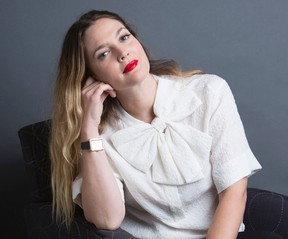 """In this Oct. 20, 2015 photo, Drew Barrymore poses for a portrait to promote her new book """"Wildflower,"""" in New York.  (Amy Sussman/Invision/AP)"""