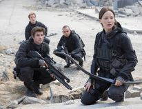 "This image released by Lionsgate shows, from left, Liam Hemsworth as Gale Hawthorne, Sam Claflin as Finnick Odair, Evan Ross as Messalla and Jennifer Lawrence as Katniss Everdeen in a scene from ""The Hunger Games: Mockingjay Part 2."" (Murray Close/Lionsgate)"