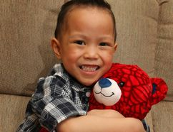 Jerylle Saquibal, 4, holds his precious Spiderman bear in his Calgary, Alta home on Thursday November 19, 2015. The boy is on a clinical trial for a drug only available in the U.S. and treatment will cost about $100,000 over the next two years. It's not covered under Alberta Health. Jim Wells/Calgary Sun/Postmedia Network