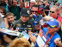 NASCAR Sprint Cup Series driver Jeff Gordon is surrounded by fans and media as he signs autographs during practice for the Ford Ecoboost 400 at Homestead-Miami Speedway. Mandatory Credit: Mark J. Rebilas-USA TODAY Sports