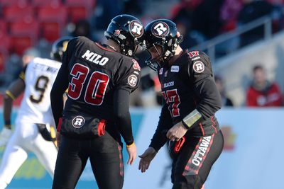 Ottawa Redblacks kicker Chris Milo (30) celebrates after kicking a field goal with teammate Thomas DeMarco during second half action against the Hamilton Tiger-Cats in the CFL East Division final in Ottawa, Sunday November 22, 2015. THE CANADIAN PRESS/Adrian Wyld