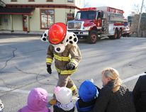 Sparky the Fire Dog reaches out to kids at the Lansdowne Santa Claus Parade on Sunday, Nov. 22.