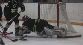 Goderich goalie Nathan Watson dives on top of the puck in a game last year. The Flyers head into playoffs in last place with only two wins. (Laura Broadley/Postmedia Network)
