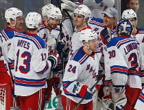 New York Rangers forward Rick Nash (61) is mobbed by teammates after scoring his third goal of the game and game winner during the overtime period of an NHL hockey game against the Florida Panthers, Saturday, Nov. 21, 2015, in Sunrise, Fla. The Rangers wo