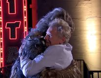 Harrison Ford and Chewbacca hug it out. (Yo