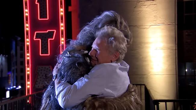 Harrison Ford and Chewbacca hug it out. (YouTube)