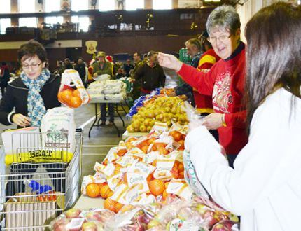 <p>Volunteers from a variety of service clubs helped pack Christmas hampers at the Cornwall Armoury in this 2011 file photo</p><p>File photo/CORNWALL STANDARD-FREEHOLDER