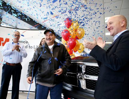 """Gino Donato/Sudbury Star Ron Proulx, a welder at Bristol Machine, was the winner in 3M Canada's 3M Cubitron 2 Discs """"Grind Like a Legend 2"""" contest and was awarded his brand new Ram 1500 SLT pickup in Sudbury on Tuesday. Blake Didone, right, co-owner of Doyle Dodge Chrysler Jeep Ram, looks on as Proulx is awarded his prize. The contest was held from April 1 to July 31 across Canada. A sticker with a unique code was placed on the Cubitron 2 product and users entered the code online. Three finalist were drawn and taken to a Motley Crue concert in Montreal where the grand prize winner was announced."""