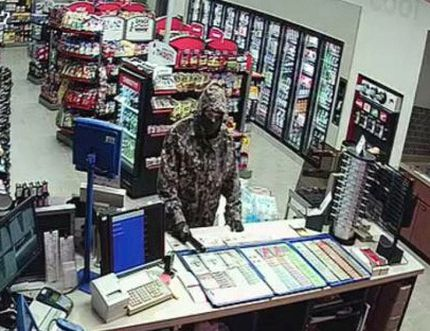 Norfolk County OPP have released an image of a suspect wanted in connection with an armed robbery at the Petro Canada gas station on Queensway West in Simcoe on Tuesday, Nov. 24, 2015. (Contributed photo)