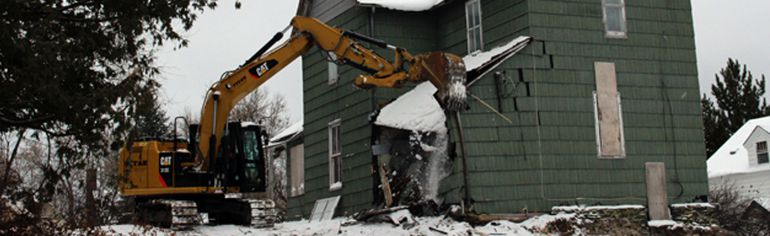 Demolition of  the 130-year-old wood frame house at 520 First St. South will make way for construction of two seniors duplexes according to property owner Don Canfield. REG CLAYTON/Miner and News