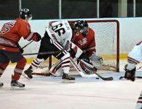 Brantford 99ers' forward Brett Parsons takes the puck in front of Stratford Cullitons goalie Carson Poulin in a game earlier this season. The 99ers play Thursday against the Kitchener Dutchmen and hope to break a five-game losing streak. (BRIAN SMILEY, The Expositor)