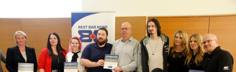 This year's accredited Best Bar None establishments hold up their certificates of accreditation during the Best Bar None Awards at Teresa Sargent Hall on Wednesday November 18.