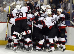 Members of the Ottawa Senators celebrate after Senators' Daniel Alfredsson scored the winning goal during overtime in Game 5 of the NHL's Eastern Conference final hockey series in Buffalo, New York, May 19, 2007.  With the win the Senators advance to the Stanley Cup.