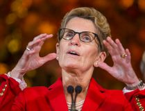 Ontario Premier Kathleen Wynne and Environment Minister Glen Murray (not pictured) talk to media about the new provincial climate change strategy at the Royal Ontario Museum in Toronto, Ont. on Tuesday November 24, 2015. Ernest Doroszuk/Toronto Sun/Postmedia Network
