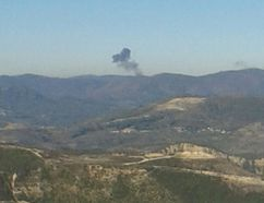 Some rises over a mountainous area in northern Syria after a war plane was shot down by Turkish fighter jets near the Turkish-Syrian border November 24, 2015. Turkish fighter jets shot down a Russian-made warplane near the Syrian border on Tuesday after repeatedly warning it over air space violations, Turkish off