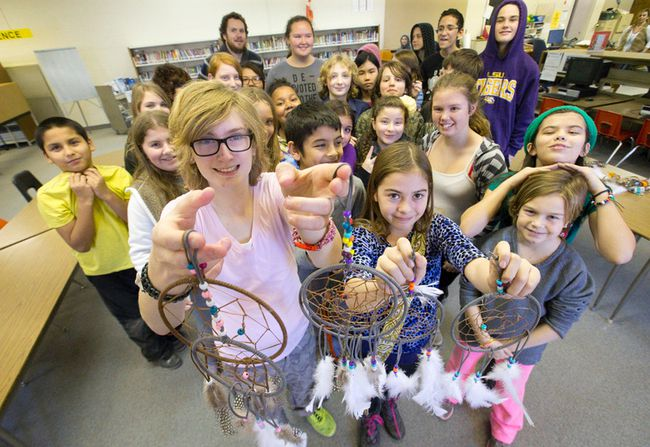 Lorne Avenue Public School pupils Natasha Didine-Lacelle and Emma Brown hold some of the dreamcatchers made by grade 6, 7 and 8 pupils to raise funds for Syrian refugees, in the library at Lorne Avenue public elementary school. (CRAIG GLOVER, The London Free Press)