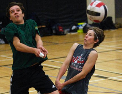 St. Joe's Celtics' Cole Clements, left, and Matthew Richards, right, nearly collide as they try and return the volleyball on Wednesday November 25, 2015 at Charles Spencer High School in Grande Prairie, Alta. The Celtics are playing at 3A provincials in Grande Prairie, Alta on Nov. 26-28. Logan Clow/Grande Prairie Daily Herald-Tribune/Postmedia Network