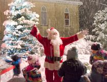 Santa Celebrates with children at his feet following having lit the Tiverton Christmas in St. Andrew's Park. (Darryl Coote/Kincardine News)