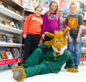 Lucknow Central Public School held its Book Fair Nov. 16-18, with potato characters coming alive through the imagination of students and the books they've been reading. Pictured: Book-famous Geronimo Stilton (Sam Hallam) strikes a pose with students (L-R) Kyla Moffat - Grade 5, Mikayla Havens - Grade 7 and Jacob Smith - Grade 7. (Darryl Coote/Kincardine News)