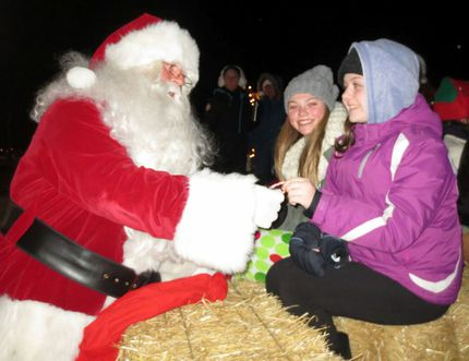 Santa determines the naughtiness or niceness of parade-goers during the 2013 Corunna Santa Claus Parade. The 2015 event takes place Saturday at 7 p.m. (File photo/ Postmedia Network)