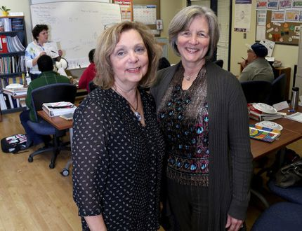 Robyn German, program manger at Language Instruction for Newcomers to Canada (LINC), and Donna Perrin, executive director of Kingston Literacy and Skills in a language class at their school on Bath Road on Thursday. (Ian MacAlpine/The Whig-Standard)