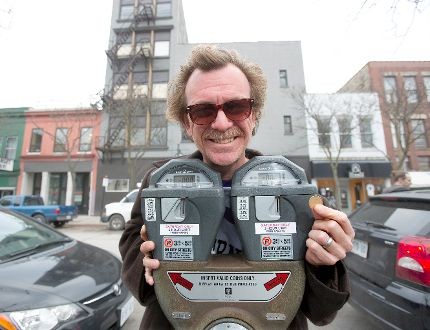 Lincoln McCardle is heading an initiative to turn old parking meters into receptacles to collect charitable donations for the homeless in London. (DEREK RUTTAN, The London Free Press)