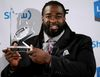 Ottawa RedBlacks' SirVincent Rogers holds his trophy after winning the Canadian Football League's Most Outstanding Offensive Lineman during the annual Shaw CFL Awards ahead of the 103rd Grey Cup in Winnipeg, Man., on Thursday November 5, 2015. Al Charest/Calgary Sun/Postmedia Network