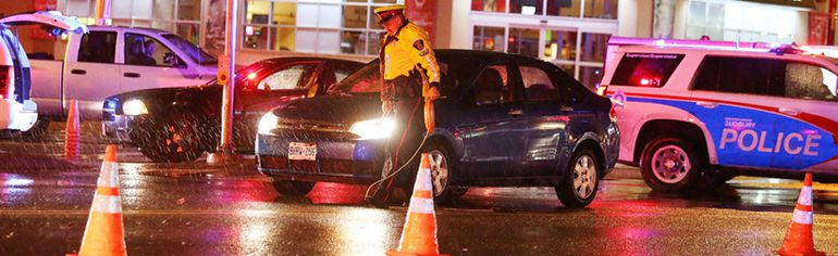 <p>Const. Rick Carr of the Greater Sudbury Police Service traffic management unit prepares to take measurements at a collision in which two pedestrians were struck at the Lloyd Street Hill on Thursday. Gino Donato/Sudbury Star/Postmedia Network