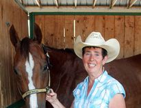 Photo courtesy Don Moon, Evergreen Park Janice Sather with one of her horses, ZoomZoomin'.